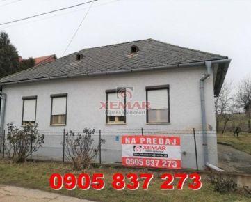 Exkluzívne ponúka na predaj starší rodinný dom s väčším stavebným pozemkom